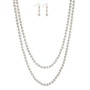 "Pearl beaded wrap necklace. Approximately 68"" in length."
