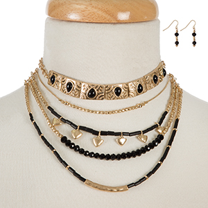 "Gold tone and black beaded layered choker with matching fishhook earrings. Approximately 12"" in length."
