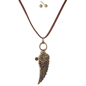 "Brown faux suede cord necklace set with a gold tone wing pendant and matching stud earrings. Approximately 30"" in length."