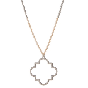 "Silver tone ivory beaded necklace with a quatrefoil pendant. Approximately 32"" in length."