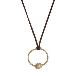 "Brown faux suede cord necklace with a gold tone pendant. Approximately 32"" in length."