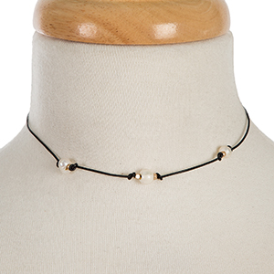 """Black waxed cord choker with three freshwater pearl beads. Approximately 12"""" in length."""