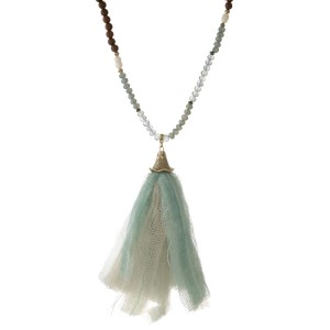 """Blue, turquoise and brown beaded necklace with a mint green and ivory fabric tassel. Approximately 32"""" in length."""