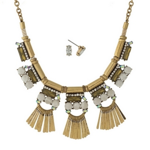 """Gold tone necklace set with white, iridescent, and clear stones, accented with metal fringe and matching stud earrings. Approximately 16"""" in length."""