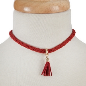 "Red crocheted choker with a tassel focal. Approximately 12"" in length."
