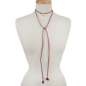 "Burgundy faux suede, open wrap choker with a gold tone star pendant. Approximately 60"" in length."