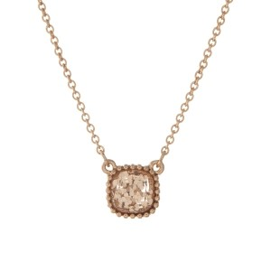 "Dainty gold tone necklace with a topaz glitter pendant. Approximately 16"" in length."