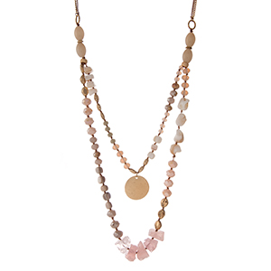 "Gold tone necklace with assorted ivory, champagne, and pink natural stones and beaded accents. Approximately 32"" in length."