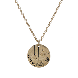 "Dainty gold tone necklace with a circle pendant stamped with ""Mom, Love, Joy."" Approximately 16"" in length."