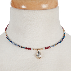 Burgundy and blue iridescent beaded memory wire choker with gold tone accents and a clear rhinestone pendant. Choker does not close, so it can fit up to almost any size.