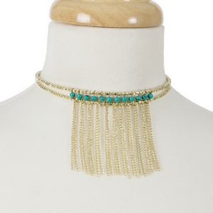 Gold tone beaded memory wire choker with turquoise beads and metal fringe. Choker does not close, so it can fit almost any size.