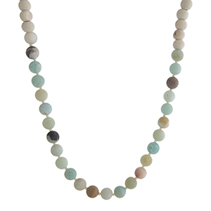 "Gold tone necklace with ivory wooden beads and amazonite natural stone beads. Approximately 36"" in length."