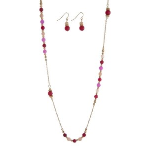 "Gold tone necklace with pink and burgundy beaded accents. Approximately 36"" in length."
