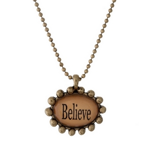 "Gold tone necklace with an epoxy ""Believe"" pendant. Approximately 16"" in length."