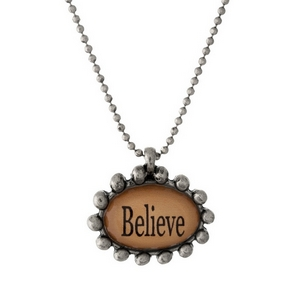 "Silver tone necklace with an epoxy ""Believe"" pendant. Approximately 16"" in length."