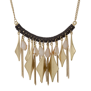 "Gold tone necklace with a curved bar, displaying chain fringe and champagne beads. Approximately 16"" in length."