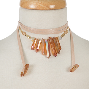 "Mauve leather wrap necklace with topaz crystals and gold tone accents. Approximately 58"" in length."