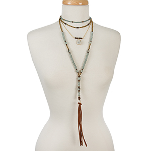 """Bronze, blue, and mint beaded layered necklace with natural stones and a tassel pendant. Approximately 12"""" in length."""