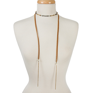 "Gold tone, beaded memory wire choker with brown suede fabric and chain tassels on the ends. Approximately 12"" in length."