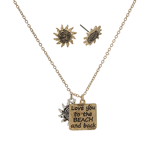"Gold tone necklace set with a square pendant stamped with ""Love you to the beach and back."" Approximately 14"" in length."