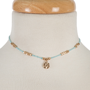 "Dainty gold tone and light blue beaded choker. Approximately 12"" in length."
