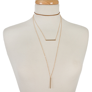 "Tan faux leather and gold tone layered choker with bar pendants. Approximately 12"" in length."