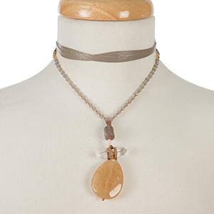 "Gold tone and gray leather wrap choker necklace with a three stone neutral pendant. Approximately 66"" in length."