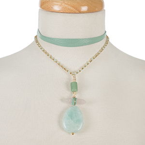 "Gold tone and mint green leather wrap choker necklace with a three stone mint pendant. Approximately 66"" in length."