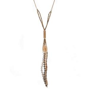 "Gold tone necklace with a bronze and gray beaded tassel. Approximately 32"" in length."