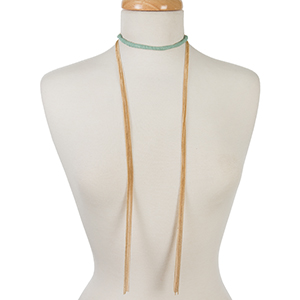 "Gold tone open wrap necklace with a mint green suede wrapped choker. Approximately 72"" in length."