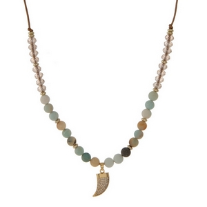 """Brown cord necklace with amazonite natural stone beads, topaz faceted beads and a gold tone horn pendant. Approximately 16"""" in length. Handmade in the USA."""