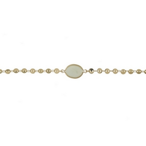 "Dainty gold tone choker with a mint green stone focal. Approximately 12"" in length."