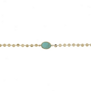 "Dainty gold tone choker with a turquoise stone focal. Approximately 12"" in length."