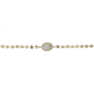 "Dainty gold tone choker with a howlite stone focal. Approximately 12"" in length."
