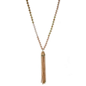 "Pink, champagne, and mint beaded necklace with a gold tone chain tassel. Approximately 32"" in length."