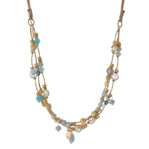 """Brown waxed cord necklace with blue, turquoise,  and gold tone beads. Approximately 18"""" in length."""