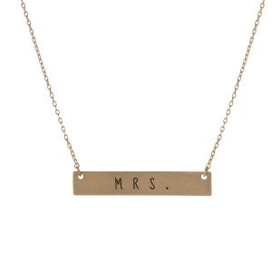 "Matte gold tone bar necklace stamped with ""Mrs."" Approximately 14"" in length."