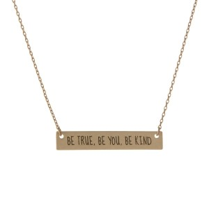 """Matte gold tone bar necklace stamped with """"Be True, Be You, Be Kind."""" Approximately 14"""" in length."""