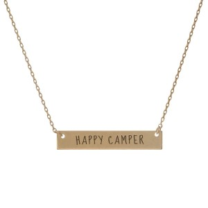 "Matte gold tone bar necklace stamped with ""Happy Camper."" Approximately 14"" in length."