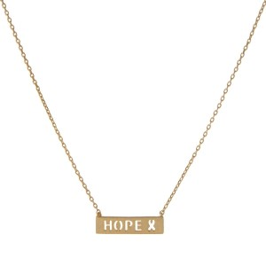 "Dainty gold tone necklace with a bar pendant stamped with ""Hope."" Approximately 14"" in length."