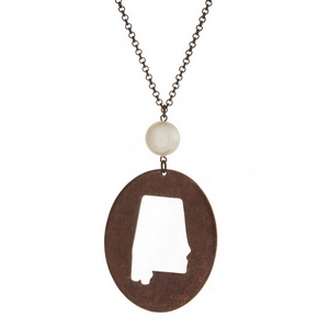 """Burnished copper tone necklace with a Alabama cutout pendant accented by a pearl bead. Approximately 30"""" in length."""