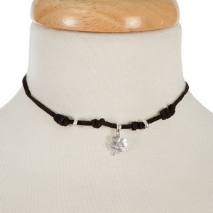 """Black faux suede choker with a silver tone four leaf clover pendant. Approximately 12"""" in length."""