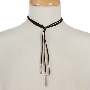 """Black faux suede lariat choker with silver tone leaf and feather pendants. Approximately 12"""" in length."""