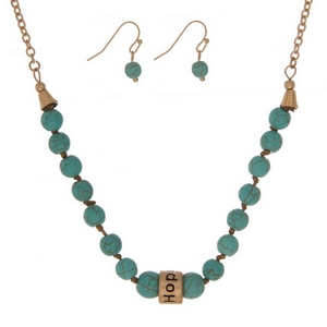 """Turquoise, natural stone beaded necklace with a gold tone bead stamped with """"Hope"""" and matching fishhook earrings."""