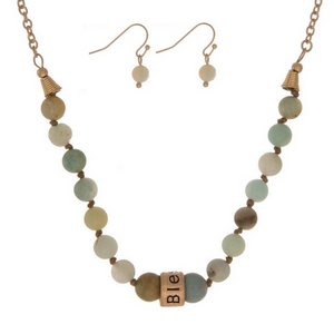 """Amazonite, natural stone beaded necklace with a gold tone bead stamped with """"Blessed"""" and matching fishhook earrings."""