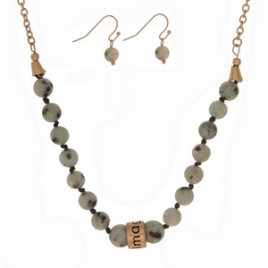 """Sesame jasper, natural stone beaded necklace with a gold tone bead stamped with """"Imagine"""" and matching fishhook earrings."""