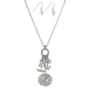 "Silver tone necklace set with anchor and sailboat charms and matching fishhook earrings. Approximately 18"" in length."
