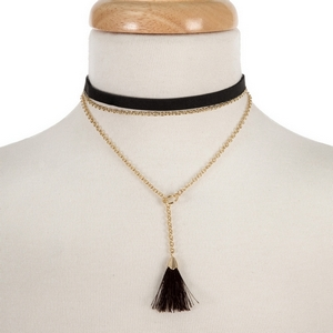 """Brown faux suede layered choker with a gold tone lariat and brown fabric tassel. Approximately 12"""" and 14"""" in length."""