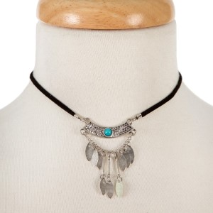 """Black faux suede choker with a silver tone and turquoise beaded bohemian pendant. Approximately 12"""" in length."""