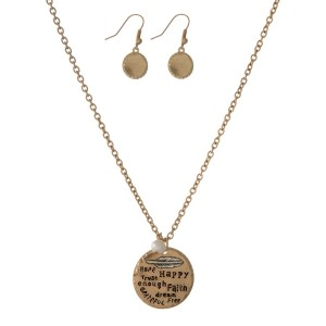 "Gold tone necklace set stamped with ""Hope, Happy, Trust, Enough, Faith, Dream, Free, Grateful"" and matching fishhook earrings. Approximately 18"" in length."